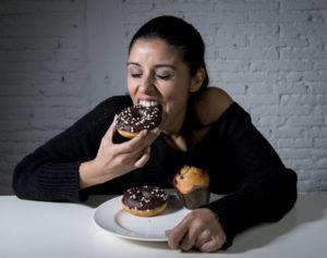 Girl eating donut